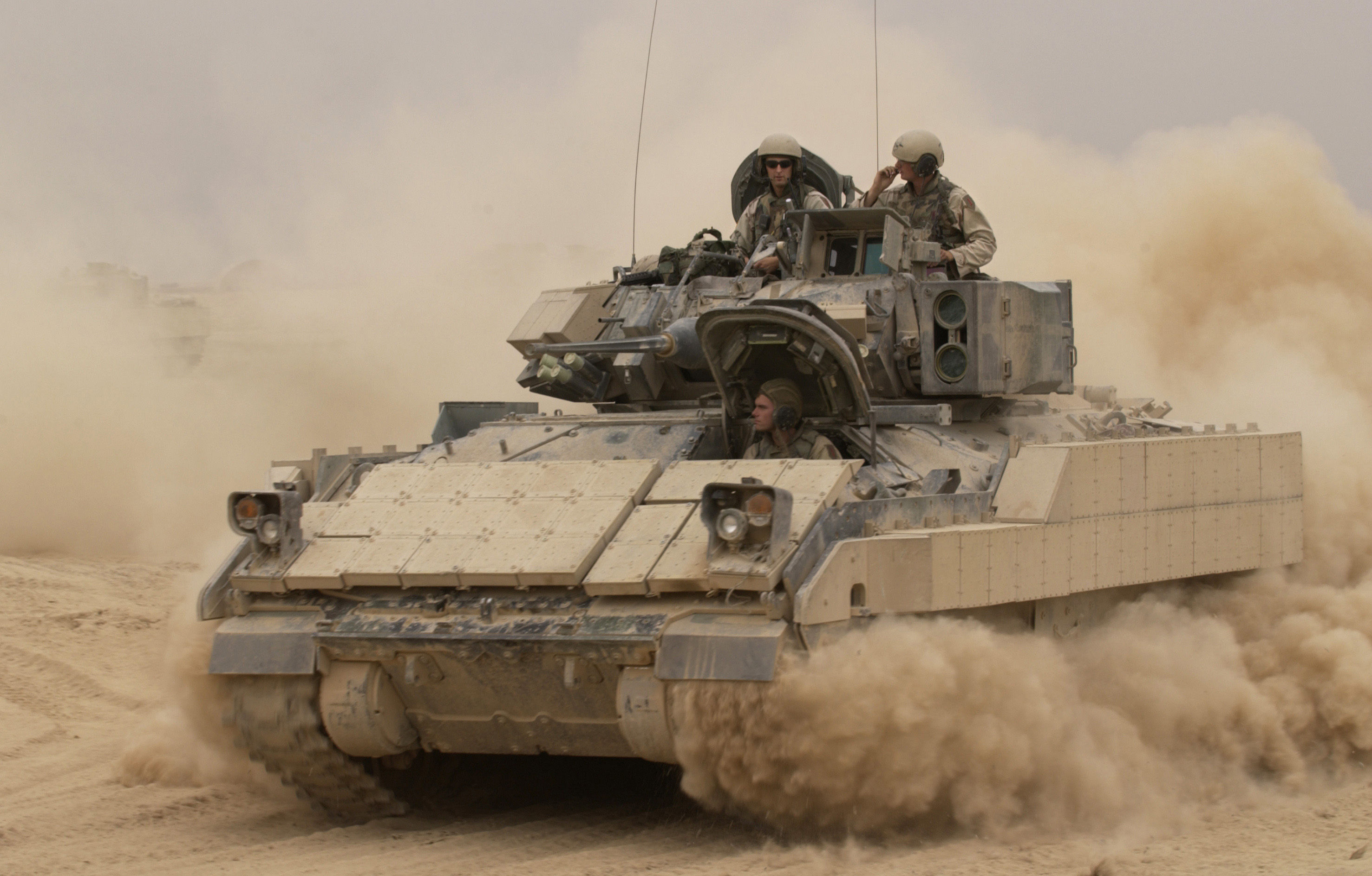 A Bradley IFV is pictured here; note the much smaller primary cannon than the tanks. Also, to the right of the turret there are two TOW missiles in a launching canister.