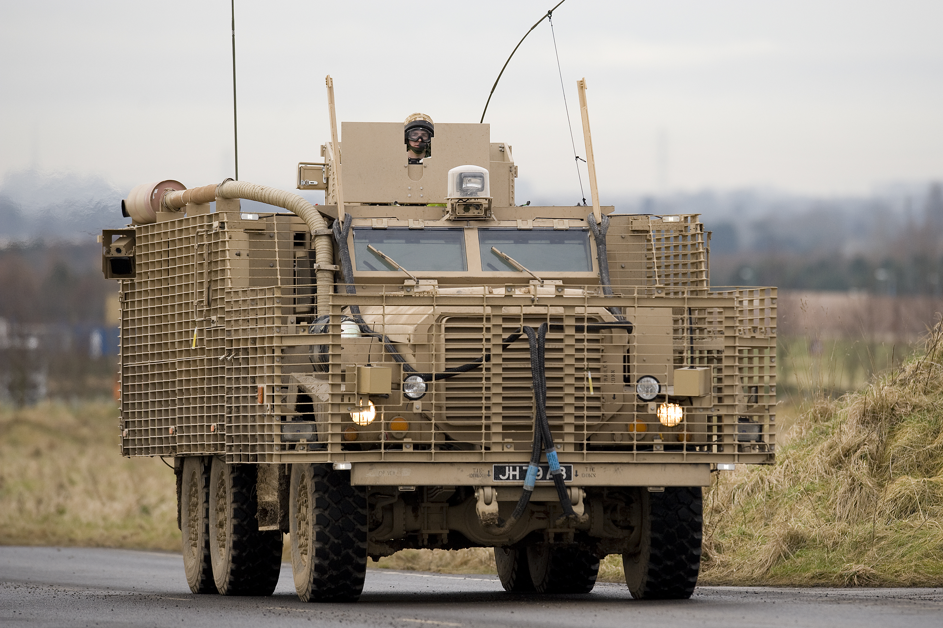 This British Mastiff MRAP is designed to protect soldiers from IED blasts. Note the truck chassis, a common feature of MRAPs.
