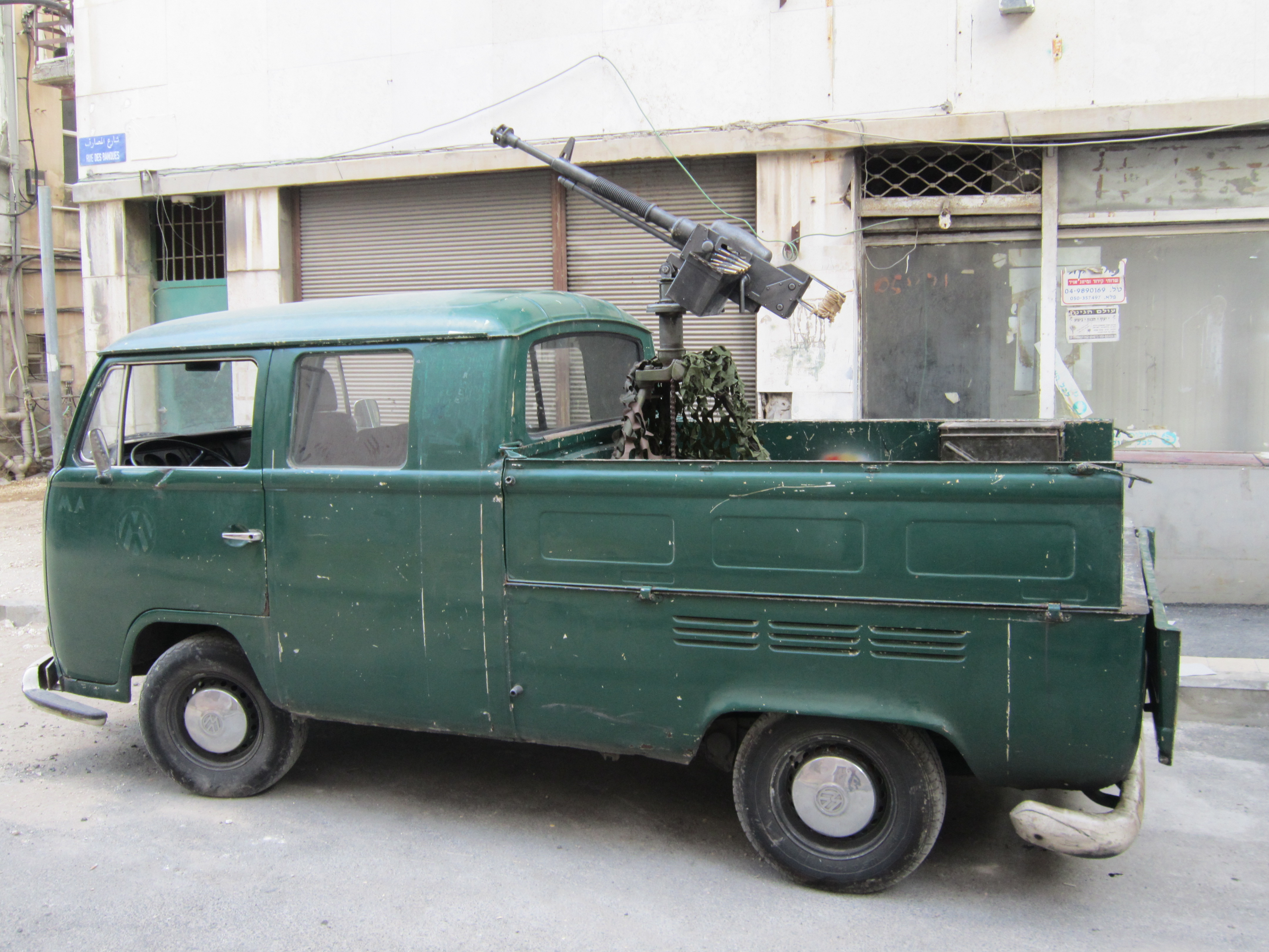 This technical consists of a machine gun mounted in the bed of a VW truck; a typical technical layout. Note the crude appearance and usage of consumer-grade vehicle as a weapon platform.