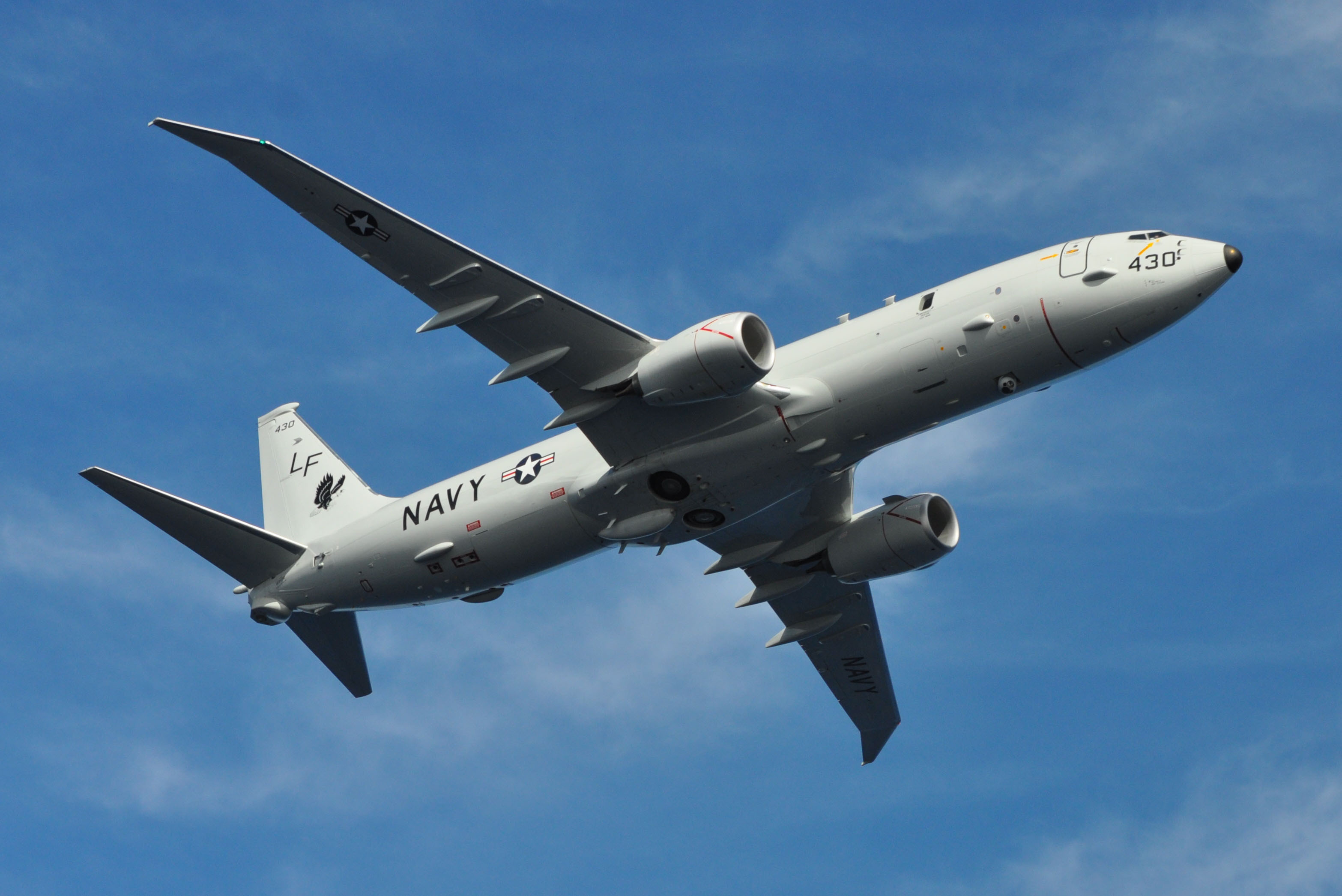 A US Navy P-8A maritime patrol aircraft flies over Jacksonville, Florida.