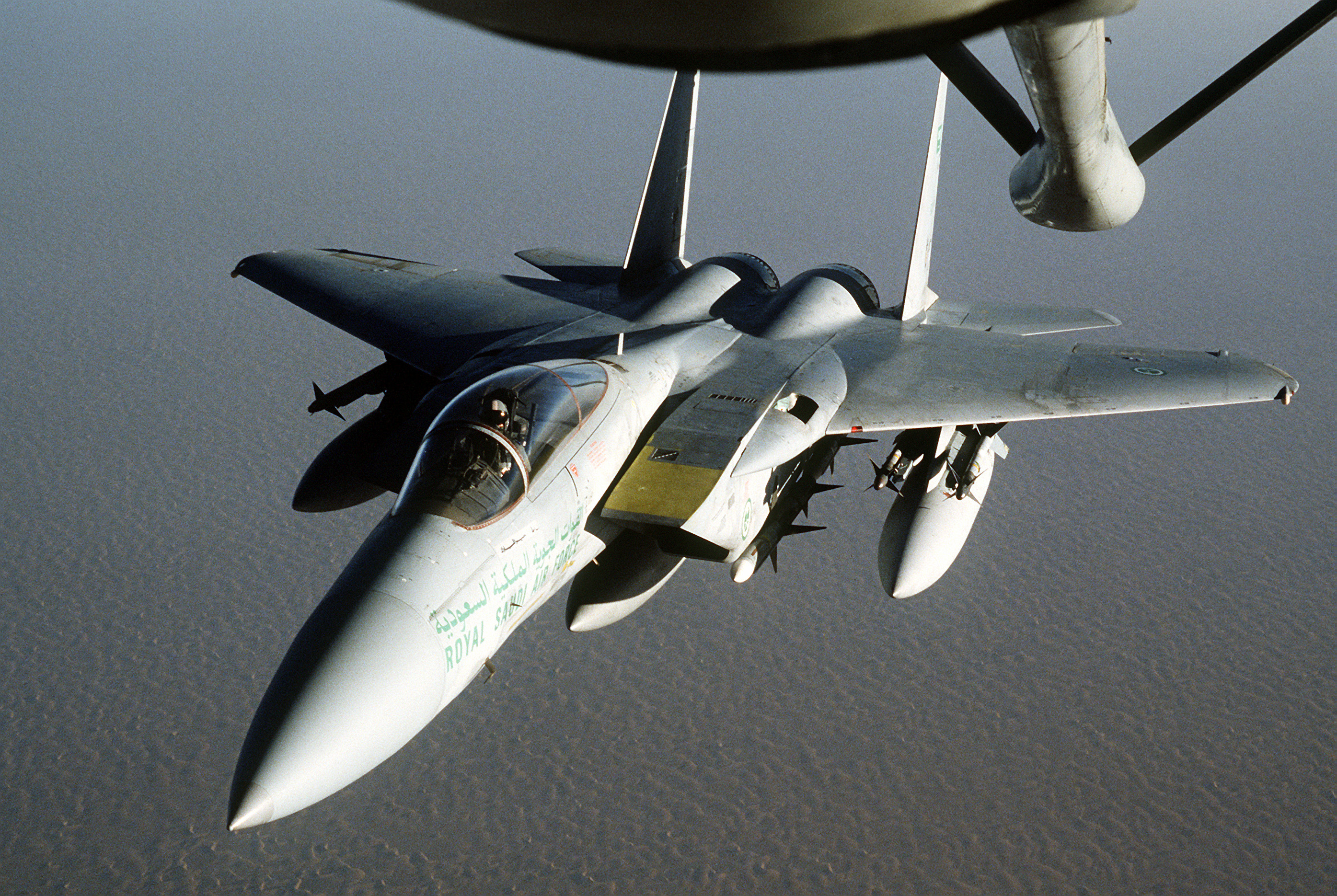 A Royal Saudi Air Force F-15 Eagle approaches a KC-135 Stratotanker for aerial refueling during Operation Desert Shield.