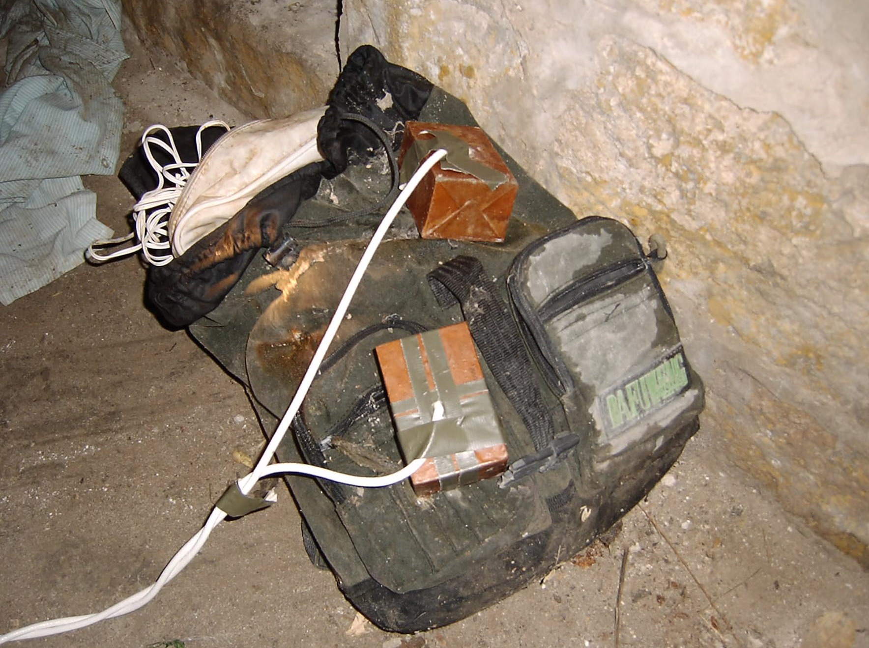 An example of a typical IED, featuring makeshift detonator assembly and backpack for carriage.