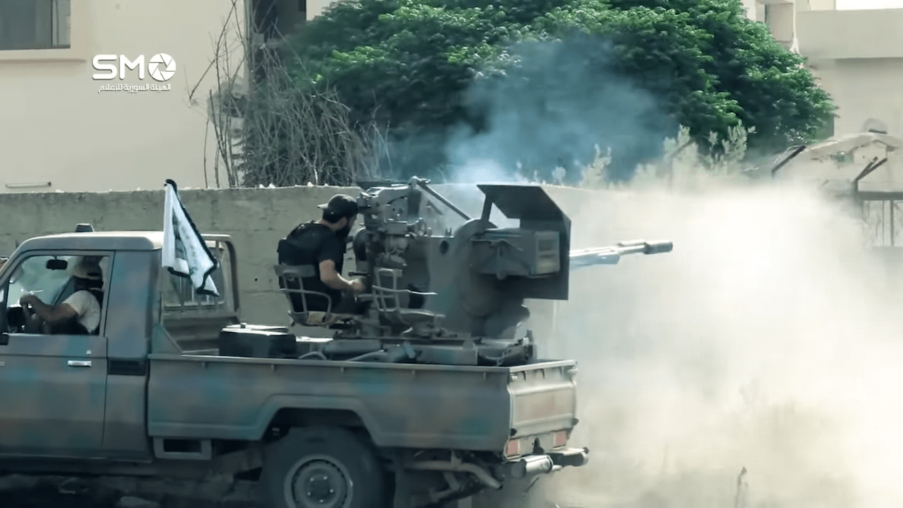 A Southern Front technical consisting of a Toyota chassis and a ZU-23-2 autocannon fires on enemy positions. Screenshot from this Southern Front video.