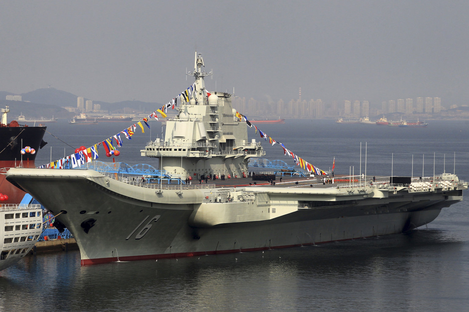 The Chinese aircraft carrier Liaoning during commissioning ceremonies. Image by Simon Yang.