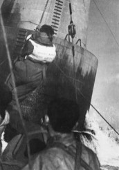 'MY LONGEST FIVE MINUTES - Stan Cooms, Plymouth engineer, leaves the Bishop Rock lighthouse by breeches bouy - marooned for twenty-nine days after a Christmas Day broadcast.