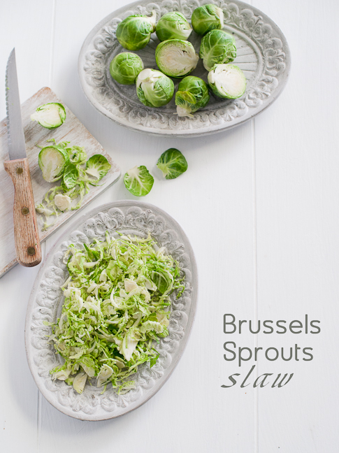 Great brussels sprouts slaw recipe made with shaved brussels sprouts and bacon. Via WhiteOnriceCouple.com