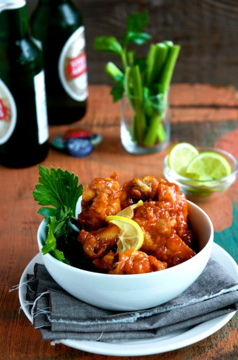 Sriracha Chicken Wings Recipe - So easy, addicting and perfect for parties. From WhiteOnRiceCouple.com