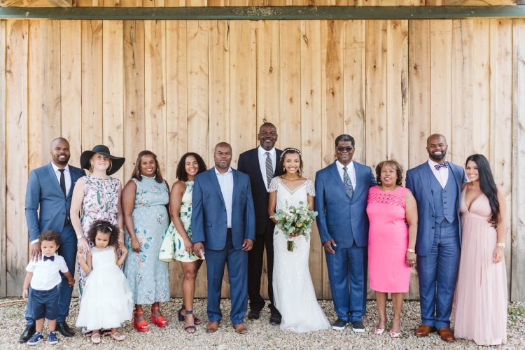 The big barn door backdrop is a great backdrop for rustic wedding pictures at White Pine Grove
