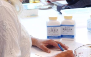 Sharon preparing a Chinese herbal formula