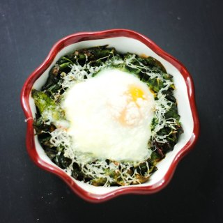 baked eggs over Swiss chard