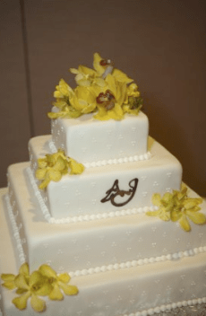 Yellow cymbidium orchids on wedding cake