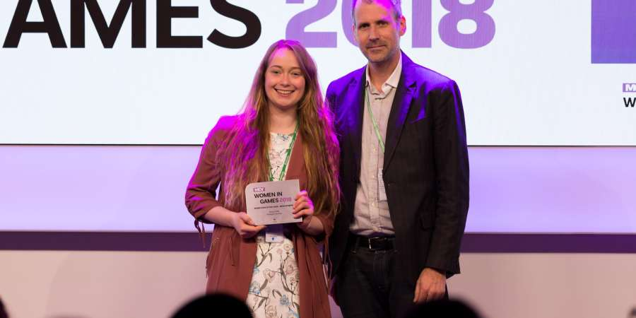 Vicky Potts (Left) recieving the Rising Star Of The Year Development award at the MCV Women In Game Awards presented by Mark Morris from Splash Damage (RIGHT)