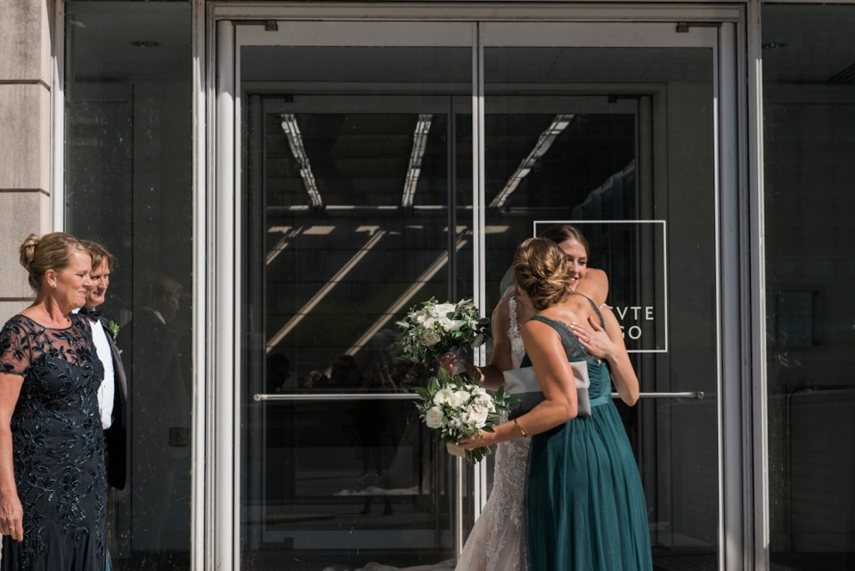 Bride hugging her sister just before the first look