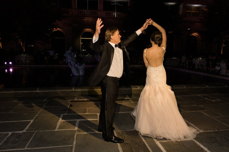 Father of the bride twirls his daughter during their father daughter dance