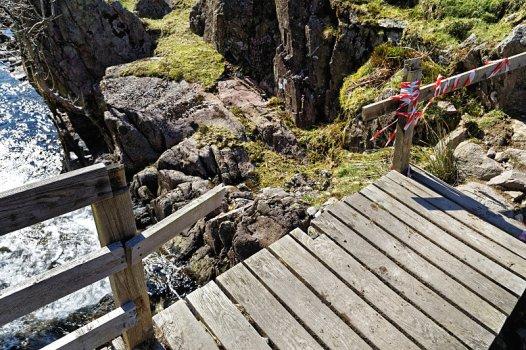 Damaged footbridge across Green Burn
