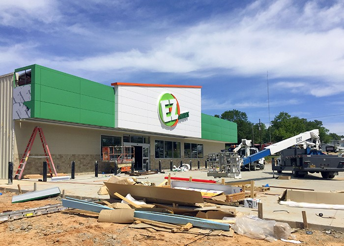 Installation of store front ACM and signage. Queen City, TX