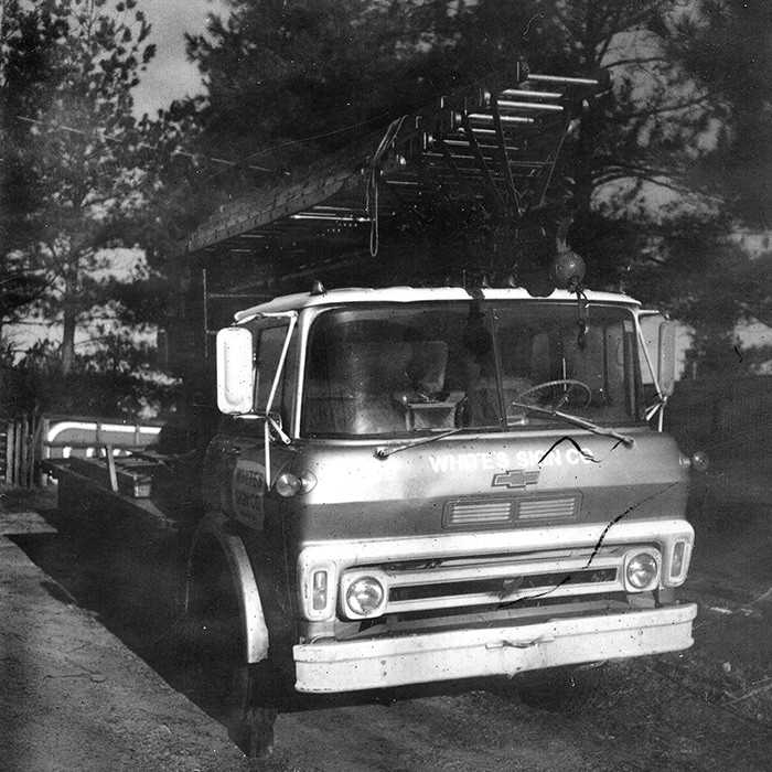 Vintage White Sign Company transport and installation truck.