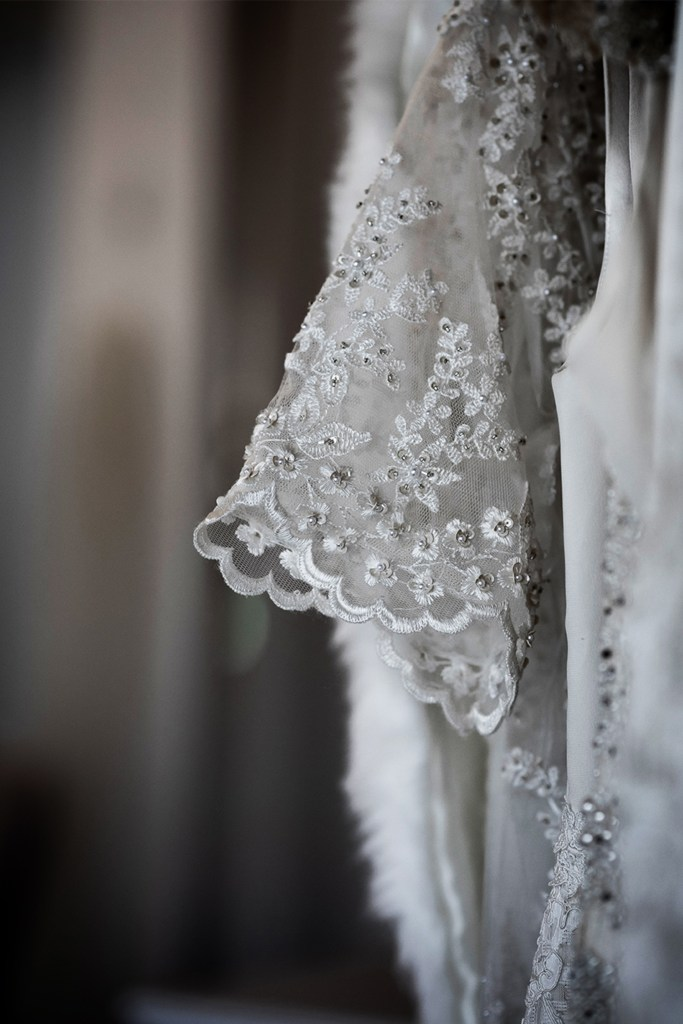 A close up of a bridal gown sleeve