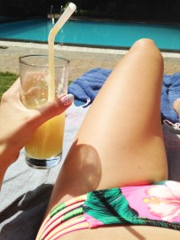 Enjoying the 4th of July with fresh pineapple juice by the pool