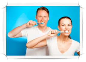 Couple brushing their teeth.