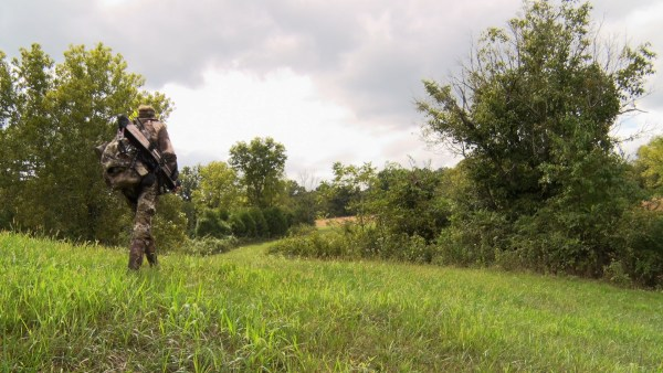 Hunter walking through the woods