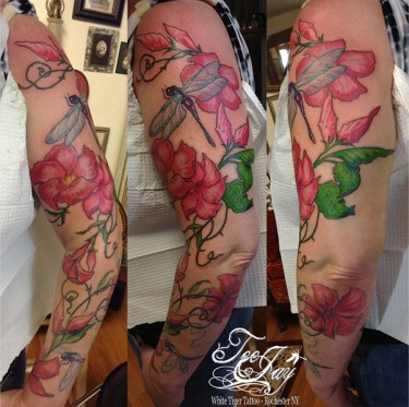 mandevilla sleeve tattoo with dragonflies