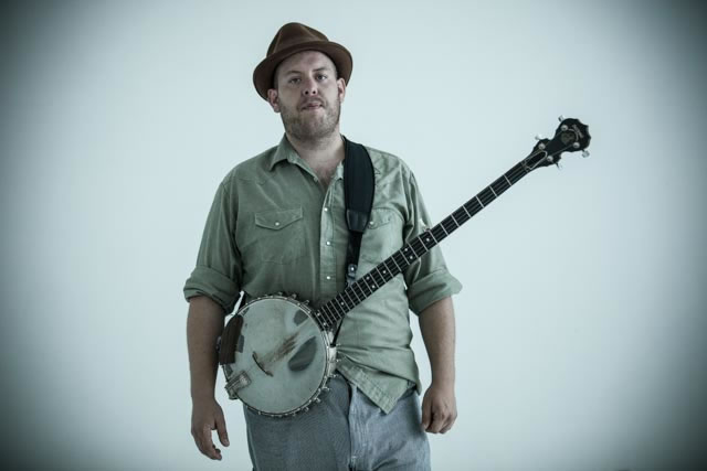 Al Scorch from Chicago, IL poses with his banjo at The White Wall in Sioux Falls