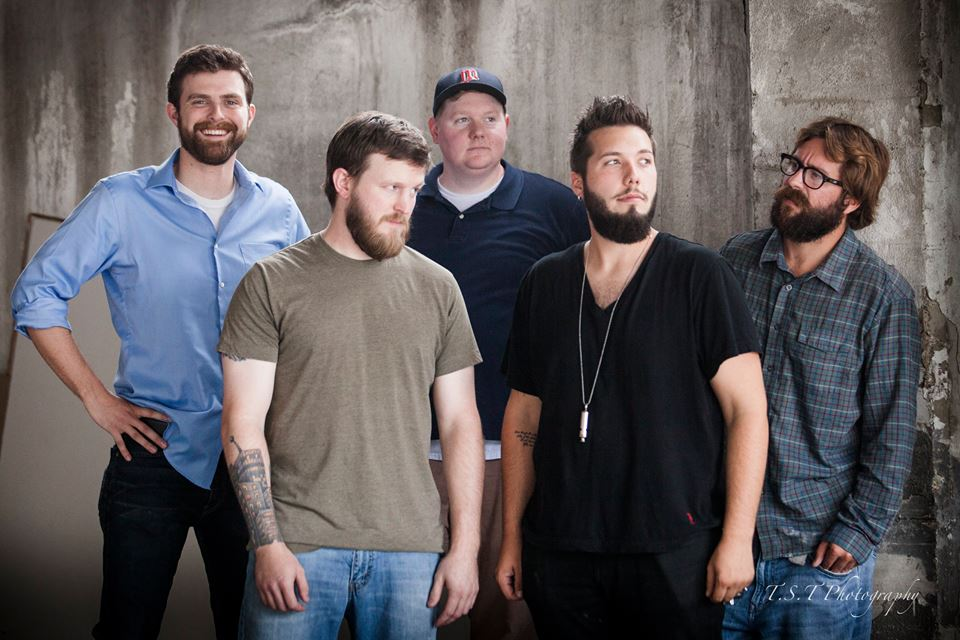 Sioux Falls' jam group, Sol Fredo, pose for the camera outside The White Wall studio