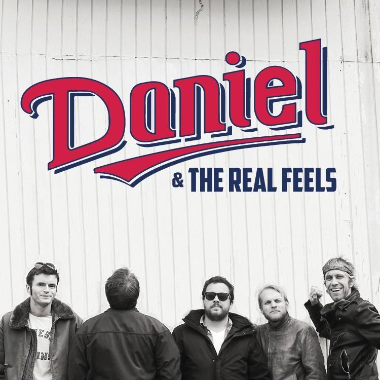 Daniel & the Real Feels pose for the camera with their logo over head
