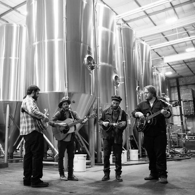 4 members of Duluth's string band, Black River Revue, play their instruments at a brewery in Minnesota