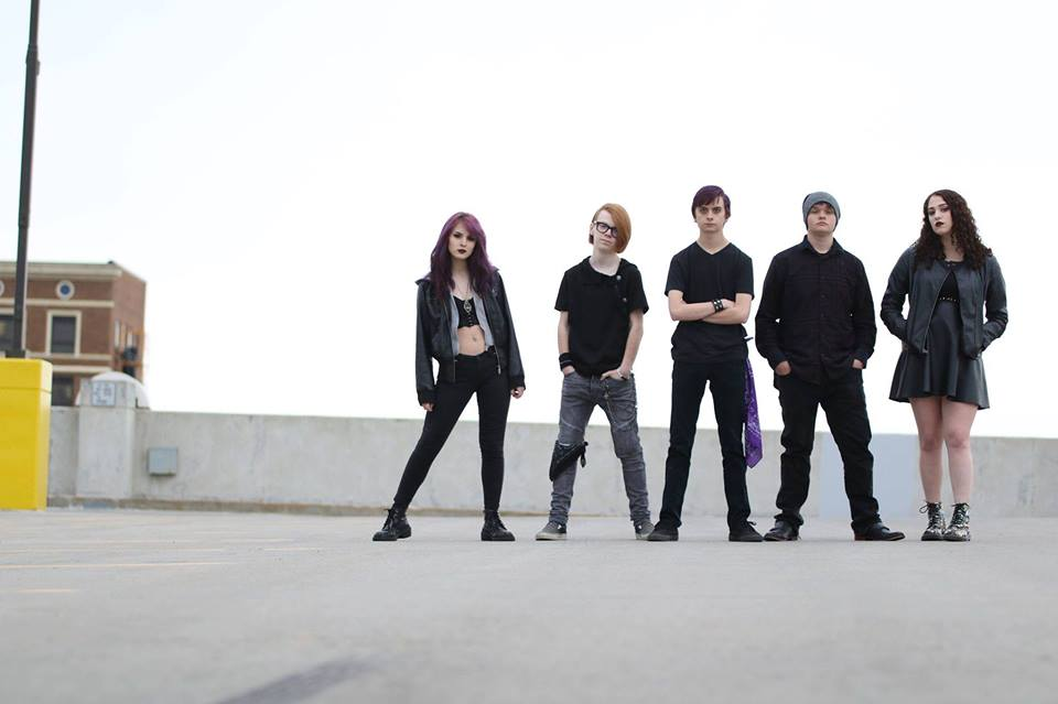 Sioux Falls' rockers, Minority Falls, stand atop a parking garage standing in a line posing