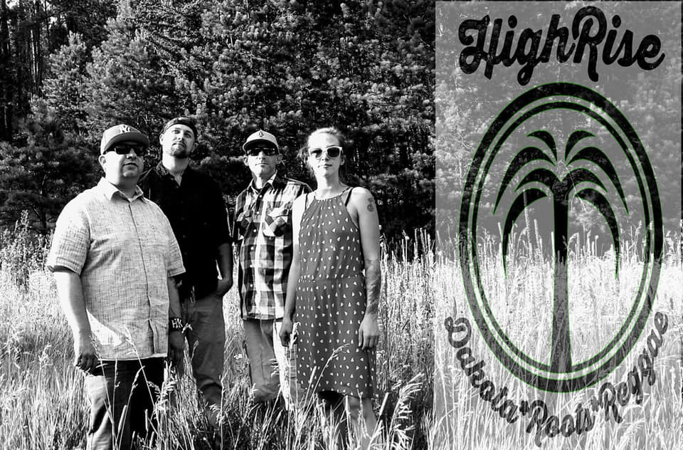 4 member of Rapid City's reggae band, High Rise, stand in front of some foilage