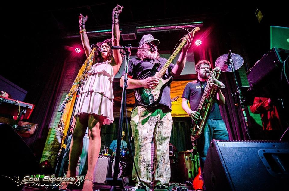 Madison's The People Brother band perform under rock n' roll lights at a festival