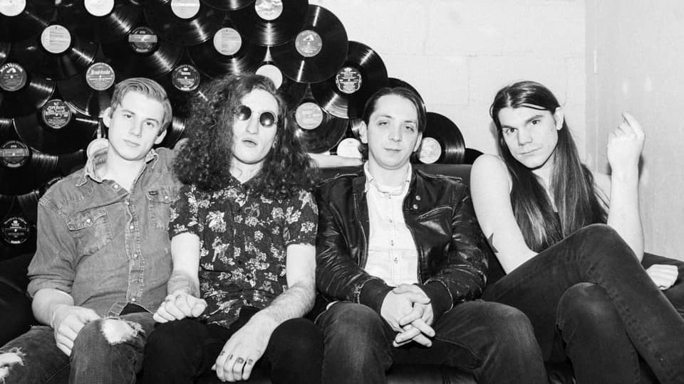 Minneapolis rockers, The Missing Letter stare stoically at the camera while sitting on a couch