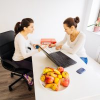 Woman visiting a nutritionist doctor for advice and treatment