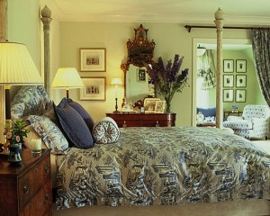 The first is quite traditional with English furniture and a blue and white toile de jouy.