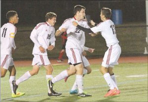 Antonio Centeio (11), Kyle Nehiley (19), Nick Haley (22) and Brian Barry (13) celebrate Haley's goal vs East Bridgewater. Later in the game, Brian McGahan (7), upper right notched a hat trick as teammates including Ben Maines (21) and Centeio join in the congratulations. Below, Jared Pendrak  makes his way to a goal. Photos by Sue Moss
