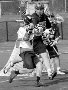 Jake Long takes a shot on goal in the 17-6 loss to Hanover April 16.                                           Photo by Sue Moss.