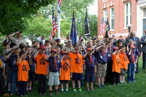 Pack 22 Cub Scouts salute as 'Taps' is played at Whitman Town Hall ceremonies during Monday's Memorial Day parade. A  Civil War re-enactment group fires a salute in Hanson. Photo by Tracy Seelye.