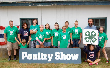 SOMETHING TO CROW ABOUT: Parent volunteers and members of the Hanson-based United Bantams 4-H Club stand behind their renovation work at the Marshfield Fairgrounds. Photo by Tracy Seelye.