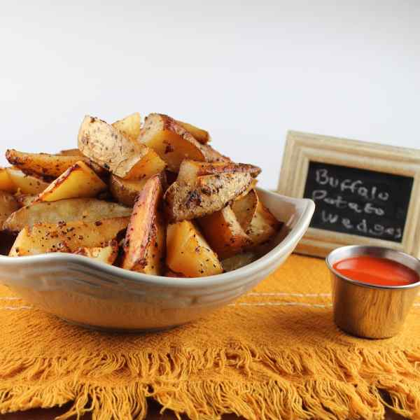 Buffalo Sauce Baked Potato Wedges