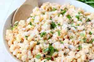 "Deconstructed Mexican Street Corn combines grilled corn ""off the cob"", cilantro, sour cream, lime juice & parmesan cheese for an amazingly flavorful side dish recipe!"