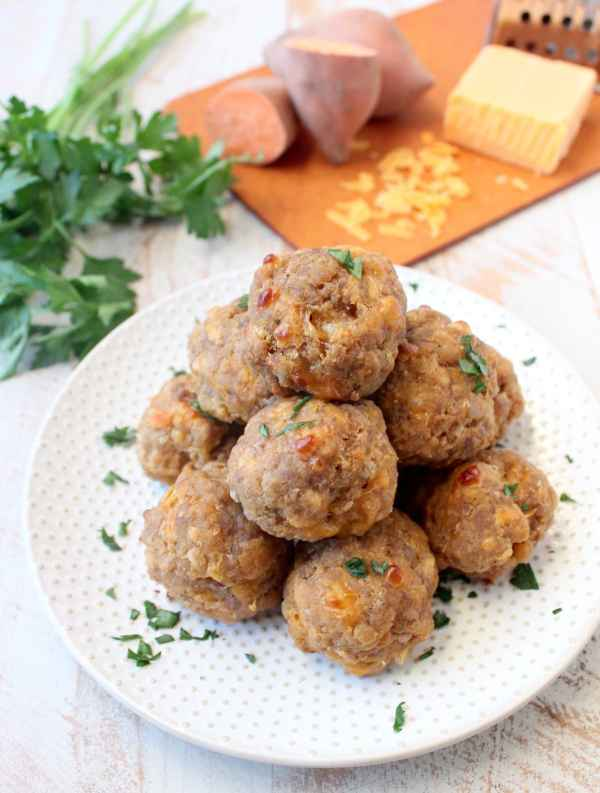 This delicious recipe for gluten free sausage balls combines creamy mashed sweet potatoes with homemade gluten free bisquick mix, cheddar cheese & sausage!