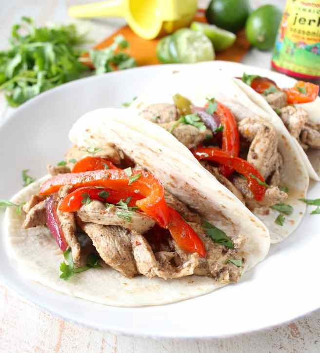 Give your chicken fajitas a taste of the Caribbean with this tasty recipe for Jerk Chicken Fajitas, made in only 20 minutes for an easy weeknight dinner!