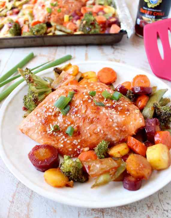 This Sheet Pan Salmon recipe with Thai Sweet Chili Sauce is easy to make in 29 minutes, it's gluten free, healthy & baked with veggies for a complete meal!