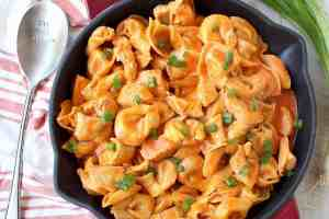 Buffalo chicken and cheese tortellini are cooked in one pot in a cheesy buffalo sauce for a seriously delicious meal made in only 20 minutes!
