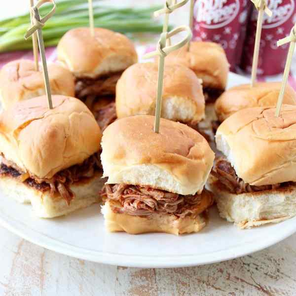 In this scrumptious recipe for Dr Pepper Pulled Pork Sliders, lean pork tenderloin is covered in a delicious spice rub, slow cooked in a Dr Pepper BBQ Sauce, then shredded & served on Hawaiian rolls.
