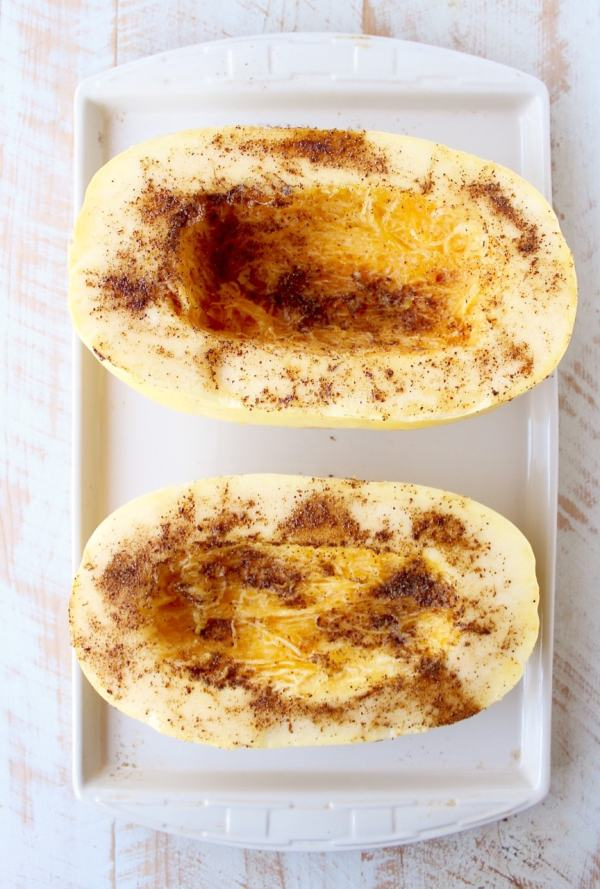 Green chili chicken is stuffed in roasted spaghetti squash and topped with gooey, melted pepper jack cheese for a delicious gluten free fall meal!