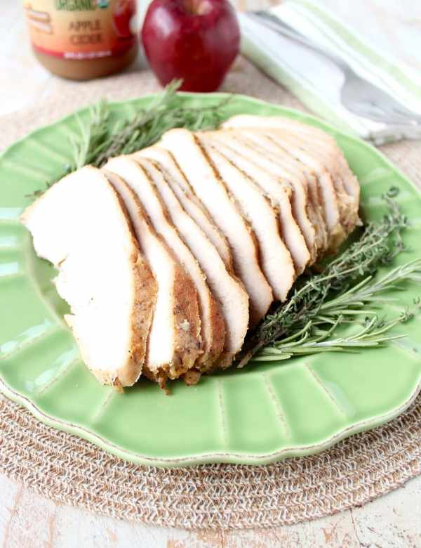 This simple slow cooker turkey breast recipe is perfect for Thanksgiving, or an easy weeknight dinner anytime! The maple apple glaze is delicious & only takes requires 4 ingredients & 5 minutes to prep!