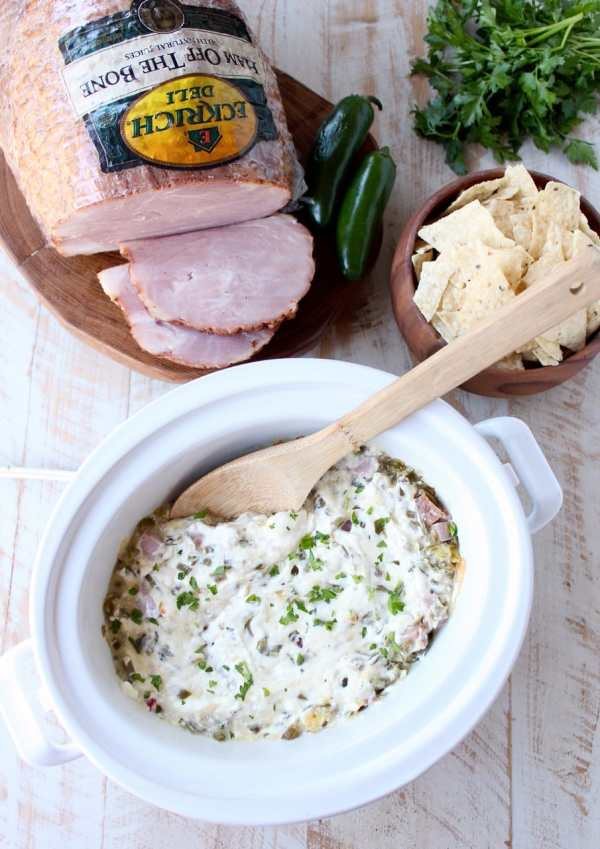 The ultimate game day party dip, this Ham and Cheese Jalapeno Popper Dip is so easy to make in the slow cooker and will be a hit with all of your friends!